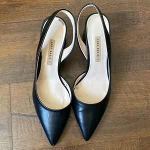 Black pointed toe sling back pumps
